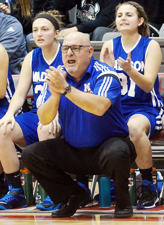 WARREN DILLAWAY / Star Beacon<br /> MIKE SMITH, Madison girls basketball coach, applauds his team on Saturday during a game at Geneva.
