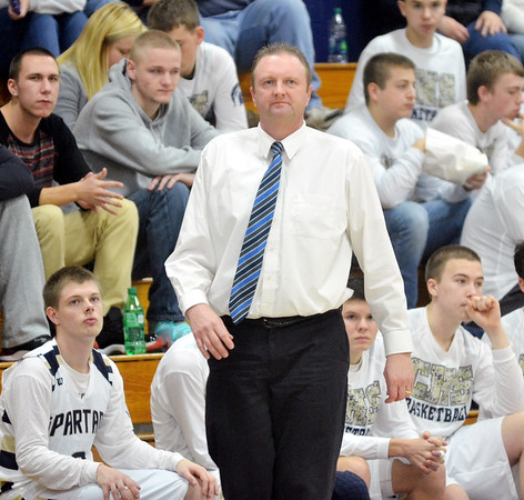 WAREN DILLAWAY / Star Beacon<br /> TIM TALLBACKA, Conneaut basketball coach, watches the action on Saturday during a home game with Madison.