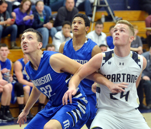 WARREN DILLAWAY / Star Beacon<br /> CHASE PETTI (22) of Madison and Marcus Barrickman (24)  of Conneaut battle for position on Saturday night during a game at Garcia Gymnasium in Conneaut.