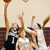 WARREN DILLAWAY / Star Beacon<br /> ALYSSA CHADWICK ((1) oof Conneaut shoots a layup     with Kat Hall (35) and Pymatuning Valley teammate Megan Stech (right) defending on Monday evening in Andover Township.