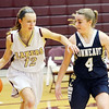 WARREN DILLAWAY / Star Beacon<br /> REBECCA DILLON (12) of Pymatuning Valley dribbles up court with Brianna Oatman (4) of Conneaut defending on Monday night in Andover Township.