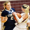 WARREN DILLAWAY / Star Beacon<br /> DANI HEINONEN (left) of Conneaut and Megan Stech of Pymatuning Valley battle for the ball on Monday evening in Andover Township.