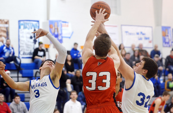 WARREN DILLAWAY / Star Beacon<br /> SAM CASKEY (33) of Jefferson fights for the ball with Gabe Arsulic (3) and Grand Valley teammate Nick Watson (32) on Tuesday evening in Orwell.