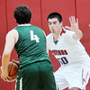 WARREN DILLAWAY / Star Beacon<br /> JEFF GONZALEZ (50) of Edgewood defends Marty Casa of Lake Catholic on Tuesday evening at Edgewood.