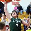 WARREN DILLAWAY / Star Beacon<br /> ELI KALIL (33) of Edgewood reaches for the ball with Joe Wallerman of Lake Catholic on Tuesday night at Edgewood.