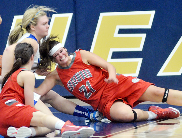WARREN DILLAWAY / Star Beacon<br /> KALEIGH SLOAN (21) of Edgewood dives for a loose ball with teammate Haley Holden (left) and Shar Miller (back left) of Grand Valley during the Conneaut Holiday Tournament at Garcia Gymnasium.