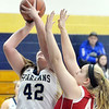 WARREN DILLAWAY / Star Beacon<br /> DANI HEINONEN (42) of Conneaut shoots as Carysa Cantrell of Ledgemont defends on Friday night during Conneaut Holiday Tournament action at Garcia Gymnasium.