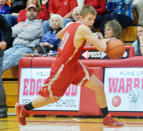 WARREN DILLAWAY / Star Beacon<br /> RYAN MACKYNEN of Geneva dribbles up court on Saturday night during a game at Edgewood.
