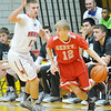 WARREN DILLAWAY / Star Beacon<br /> BEN DAMM of Geneva dribbles as Mason Lilja of Edgewood defends on Saturday evening at Edgewood.