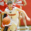 WARREN DILLAWAY / Star Beacon<br /> MITCHELL DRAGON of Edgewood leads a fastbreak for the Warriors on Saturday night during a home game with Geneva.