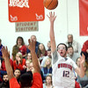WARREN DILLAWAY / Sar Beacon<br /> JACOB BLEIL (12) of Edgewood shoots over Travon Miller of Geneva on Saturday at Edgewood.