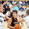 WARREN DILLAWAY / Star Beacon<br /> CHASE THURBER (center) of Pymatuning Vally squeeezes between Conneaut  defenders Alex Gerdes (4) and Troy Colucci (5) on Tuesday evening at Garcia Gymnasium in Conneaut.