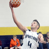 WARREN DILLAWAY / Star Beacon<br /> ALEX GERDES of Conneaut drives for a layup on Tuesday evening during a home game with Pymatuning Valley.