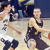 WARREN DILLAWAY / Star Beacon<br /> JACOB O'carz (with ball) of Pymatuning Valley prepares to pass as Adam Laitinen of Conneaut defends on Tuesday night at Conneaut's Garcia Gymnasium.
