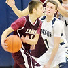 WARREN DILLAWAY / Star Beacon<br /> JUSTIN MYERS of Conneaut (facing) defends Aaron Cross (with ball) of Pymatuning Valley on Tuesday night at Garcia Gymnasium in Conneaut.