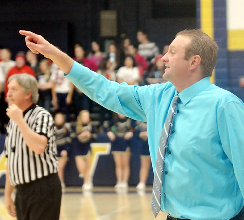 WARREN DILLAWAY / Star Beacon<br /> TIM TALLBACKA, Conneaut boys basketball coach, instructs his team on Tuesday evening during a home game with Pymatuning Valley.