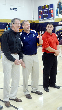 WARREN DILLAWAY / Star Beacon<br /> GREG SWEET, owner of Greg Sweet Chevrolet-Buick, (left) talks with Conneaut Area City Schools Superintendent Michael Notar as school board president Chris Newcomb looks on (right) on Tuesday evening during a ceremony to honor Sweet's donation of two scoreboards to Garcia Gymnasium.