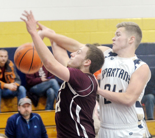 WARREN DILLAWAY / Star Beacon<br /> MARCUS BARRICKMAN (right) of Conneaut blocks a shot by  Joey Hunt (left) of Pymatuning Valley on Tuesday night at Garcia Gymnasium in Conneaut.