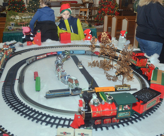 WARREN DILLAWAY / Star Beacon<br /> VINNIE HUNT, 8, of Jefferson Township watches a model train on Saturday at the Jefferson Historical Society.