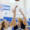 WARREN DILLAWAY / Star Beacon<br /> ALLIE HOLMES (left) of Grand Valley blocks a shot by Dani Heinonen of Conneaut on Saturday afternoon in Orwell.