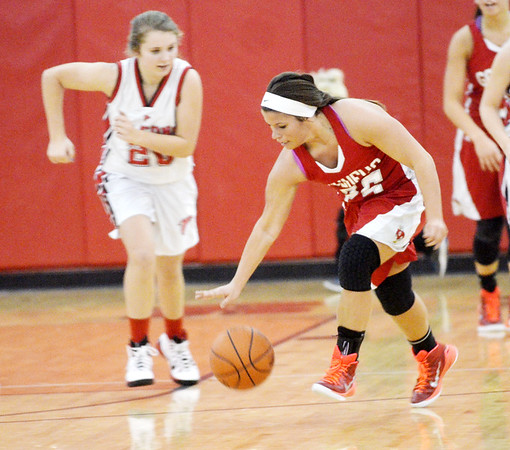 WARREN DILLAWAY / Star Beacon<br /> COURTNEY HARRIMAN (25) of Geneva dribbles up court during a Saturday evening game at Jefferson.
