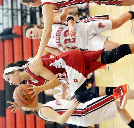 WARREN DILLAWAY / Star Beacon<br /> LINDSEY MAYLE of Geneva drives to the basket on Saturday evening in Jefferson.