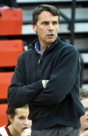 WARREN DILLAWAY / Star Beacon<br /> STEVE LOCY, Jefferson girls basketball coach, watches the action on Saturday night during a home game with Geneva.