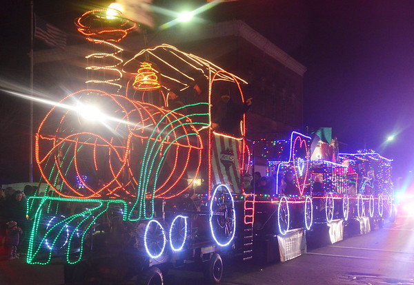 WARREN DILLAWAY / Star Beacon<br /> A COLORFUL train float concluded the Jefferson Christmas Parade on Saturday evening.