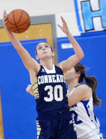 WARREN DILLAWAY / Star Beacon<br /> LEXI ZAPPITELLI (30) of Conneaut pulls down the ball in front of Alexis Cassesa of Grnd Valley on Saturday afternoon in Orwell.