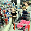 WARREN DILLAWAY / Star Beacon<br /> BRONTA BELL-PACHECO (left) and siblings Titus, 1, (in cart) and Malachi Pacheco, 15, shop with their mother Sherry Pacheco during the Conneaut Shop with an Officer program at the Super KMart in Ashtabula Township on Saturday morning.