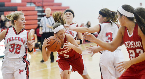 WARREN DILLAWAY / Star Beacon<br /> EMILY HARRIMAN (5) of Geneva stumbles while driving between three Jefferson defenders Raquel Fularz (32), Emily Smock (back center) and Jessica Becker (3) on Saturday evening as Eagle teammate Sarah Juncker waits for theball.