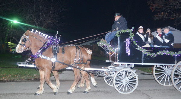 WARREN DILLAWAY / Star Beacon<br /> ASHTABULA COUNTY Fair royalty were transported along the Jefferson Christmas Parade route on a horsedrawn carriage on Saturday evening.