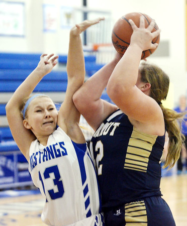 WARREN DILLAWAY / Star Beacon<br /> CASSADY KINGDOM (13) of Grand Valley defends Carly Kay of Conneaut on Saturday afternoon in Orwell.