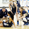 WARREN DILLAWAY / Star Beacon<br /> TONY PASANEN, Conneaut girls basketball coach, talks         with an injured Alyssa Chadwick as her teammates Keeley Cole (2) and Dani Heinonen (right) look on Saturday afternoon in Orwell during a game with Grand Valley.