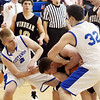 WARREN DILLAWAY / Star Beacon<br /> AUSTYN SPOON (2) and Grand Valley teammate Nick Watson (32) trap Dakota Harmotta of Windham on Friday evening in Orwell during opening night basketball action.
