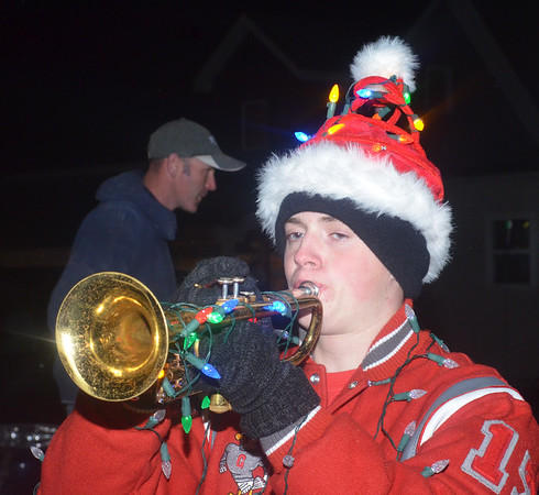 WARREN DILLAWAY / Star Beacon<br /> MARKELL JOY was dressed for the holiday while playing for the Geneva High School band on Friday evening prior to the Christmas parade in downtown Geneva.