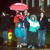 WARREN DILLAWAY / Star Beacon<br /> CHRISTMAS PARADE fans wave to participants on Friday evening in Geneva.