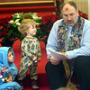 WARREN DILLAWAY / Star Beacon<br /> REV. PETER NIELSEN presents the Christmas story to a group of people including Carter Cline, 4, and his brother  Jasper (standing) , both of Kingsville Township, during a Christmas Day service at St. Peter's Episcopal Church in Ashtabula on Thursday morning.