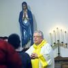 WARREN DILLAWAY / Star Beacon<br /> REV. JOHN MADDEN presides over a Christmas Mass on Thursday at Sacred Heart Church in Rock Creek.