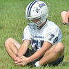 WARREN DILLAWAY / Star Beacon<br /> DANE GUSTAFSON  stretches on Friday during the first day of football practice at Massucci Field in Ashtabula.