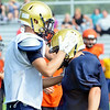 WARREN DILLAWAY / Star Beacon<br /> TROY COLUCCI  of Conneaut (right) is congratulated by teammate Marcus Barrickman after Colucci's tacked on tuesday morning during a scrimmage at Conneaut High School football stadium.