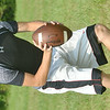 WARREN DILLAWAY / Star Beacon<br /> ZACH Thomas (right) of St. John works on a drill during the first day of football practice at Massucci Field in Ashtabula.