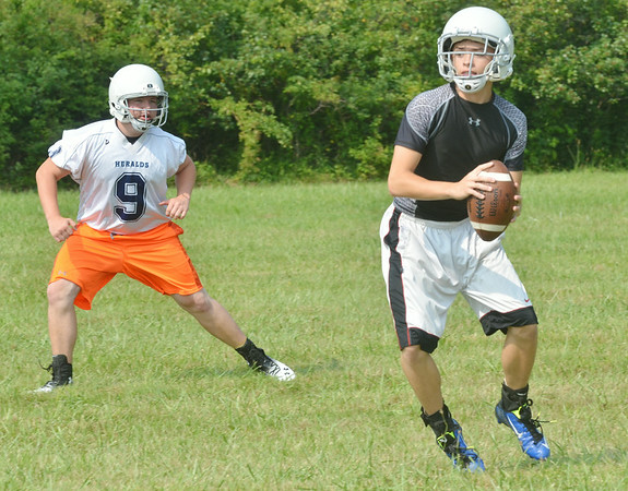 WARREN DILLAWAY / Star Beacon<br /> ZACH THOMAS (right) and St. John teammate Mike Leonard work on a drill during the first day of football practice at Massucci Field in Ashtabula.