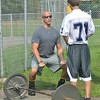 WARREN DILLAWAY / Star Beacon<br /> CHRIS MONDA, St. John strength coach, works with Josh Williams during the first day of  football practice on Friday at Massucci Field in Ashtabula.