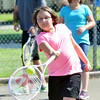 WARREN DILLAWAY / Star Beacon<br /> EMILY KINNEAR, 10, works on a drill at the Conneaut City Recreation Tennis Camp on Thursday morning in Conneaut.
