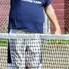 WARREN DILLAWAY / Star Beacon<br /> DAVID SIMPSON instructs campers during the Conneaut City Recreation Tennis Camp on Thursday morning.