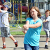 WARREN DILLAWAY / Star Beacon<br /> ISABELLA DANFORTH, 11, (center), Jacob Wiley, 11, (left) and BillySchmaeman, 11, work on drills during the Conneaut City Recreation Tennis Camp on Thursday morning.