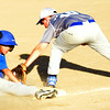 WARREN DILLAWAY / Star Beacon<br /> DMITRI DRAGAS (left) of Madison slides into third base as Andrew Verhas of Grand Valley applies a tag during minor league all-star action at Madison.