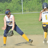 WARREN DILLAWAY / Star Beacon<br /> KATIE JO HAAS (left) of Conneaut catches the ball as Katie Hussing of Tallmadge arrives safely at second base during state major league all-star action at Cederquist Park in Ashtabula on Friday evening.