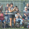 WARREN DILLAWAY / Star Beacon<br /> TALLMADGE FANS applaud their team on Friday night during a 16-0 win over Conneaut during the state tournament major league all-star tournament at Cederquist Park in Ashtabula.